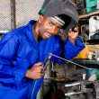 Happy african american welder in workshop — Stock Photo #14754095