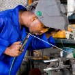African american welder working in workshop — Stock Photo
