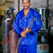 African male welder with gas welding machine — Stock Photo