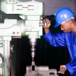 African american industrial drilling machine operator — Stock Photo