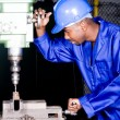 African american factory worker working in workshop — Stock Photo