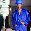 African american machinist portrait in factory workshop - Stock Photo