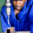 African american machinist working on tooling machine — Stock Photo