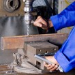 Operator working on industrial drilling machine in workshop — Stock Photo #14754133