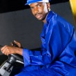 African american forklift driver in factory - Stock Photo