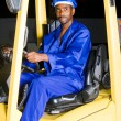Stock Photo: African american male forklift driver