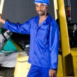 African forklift driver standing next to a forklift — Stock Photo #14754151