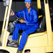 African american industrial forklift driver on forklift — Stock Photo