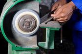 Man working on grinding machine — Stock Photo