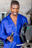 Happy african american welder in workshop — Stock Photo