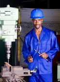 African american machinist portrait in factory workshop — Stock Photo