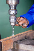 African male machinist working on industrial drilling machine — Stock Photo