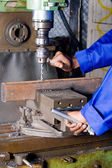Operator working on industrial drilling machine in workshop — Stock Photo