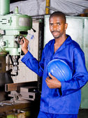 African american industrial blue collar worker in workshop — Stock Photo