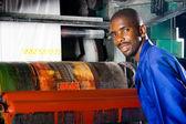 African plastic bag printing machine operator at work — Stock Photo