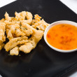Crispy fried calamari and chilli sauce - Stock Photo
