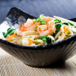 Chinese style seafood noodles in a bowl — Stock Photo
