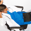 Overhead view of young indian doctor with laptop - Stock Photo
