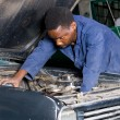 Stock Photo: Africamericmechanic repairing vehicle