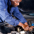 Royalty-Free Stock Photo: African amercian fixing car in garage