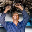 African american auto mechanic at work — Stock Photo #14775481