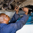African american auto mechanic at work - Stock Photo
