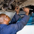 African american auto mechanic at work — Stock Photo