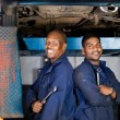 Two african american mechanics inside garage — Stock Photo