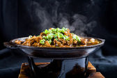 Hot chinese food with steam — Stock Photo
