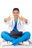 Cheerful indian medical intern giving thumbs up — Stock Photo