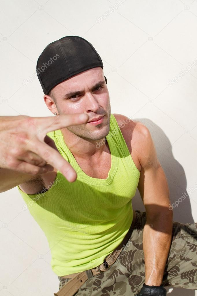 Cool hip hop man with hand sign — Stock Photo #14774557