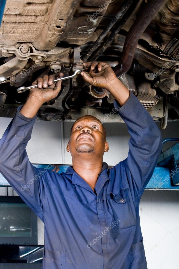 African American Auto Mechanic At Work Stock Photo