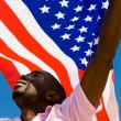 Stock Photo: African american man with USA flag