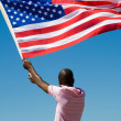 African american man with USA flag - Stock Photo