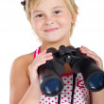 Cute little girl with binoculars — Stock Photo