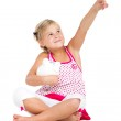 Little girl with piggybank and pointing — Stock Photo #14818575