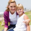 Young mother and daughter outdoors - Stock Photo