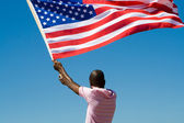African american man with USA flag — Stock Photo