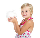 Cute little girl holding a piggy bank — ストック写真