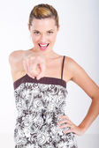 Young woman pointing towards camera — Stock Photo