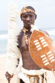 Native african man with traditional clothing on beach — Stock Photo