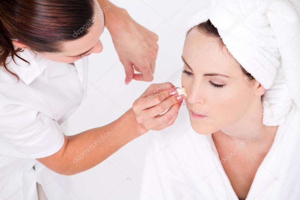 Professional female makeup artist applying makeup to model's face  Stock Photo #14817601
