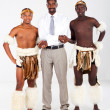 Modern african businessman and traditional tribesman — Stock Photo
