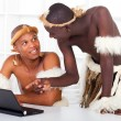 Two african tribesman learning computer — Foto Stock
