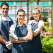 Group of florists portrait in greenhouse - Stock Photo