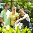 Young couple shopping for plants in greenhouse — Stock Photo #14899907
