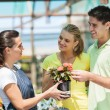 Young couple buying flowers in nursery — Stock Photo #14899909