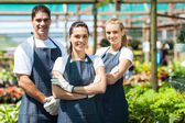 Group of florists portrait in greenhouse — Stock Photo