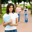 Beautiful young college student on campus — Stock Photo #14903529