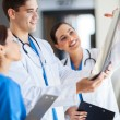 Group of healthcare workers working together — Stock Photo